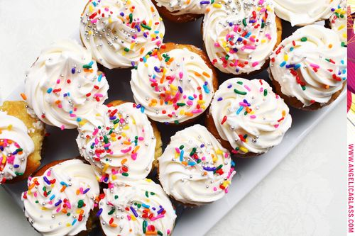 rainbow-sprinkle-cupcakes-yellow-white-frosting