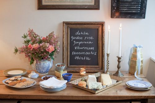 cheese-spread-flower-arranging-birthday-party-crackers-and-cheese-display-chalkboard-as-decor